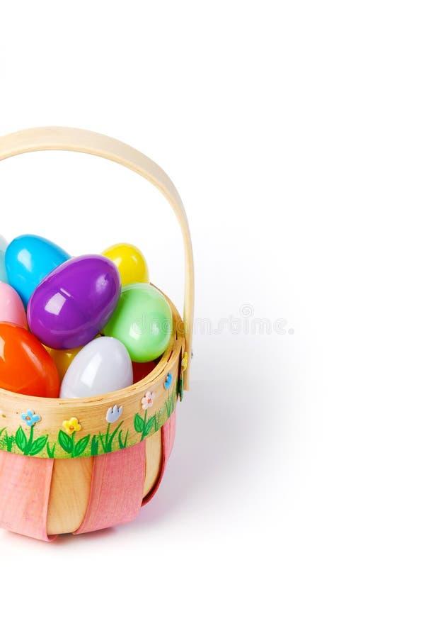 rosafarbener ostern korb mit bunten eiern stockfoto bild. Black Bedroom Furniture Sets. Home Design Ideas