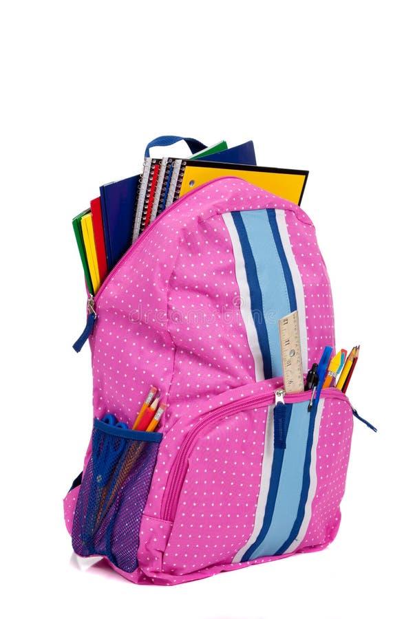 Rosafarbener Rucksack mit Schulezubehör lizenzfreie stockbilder