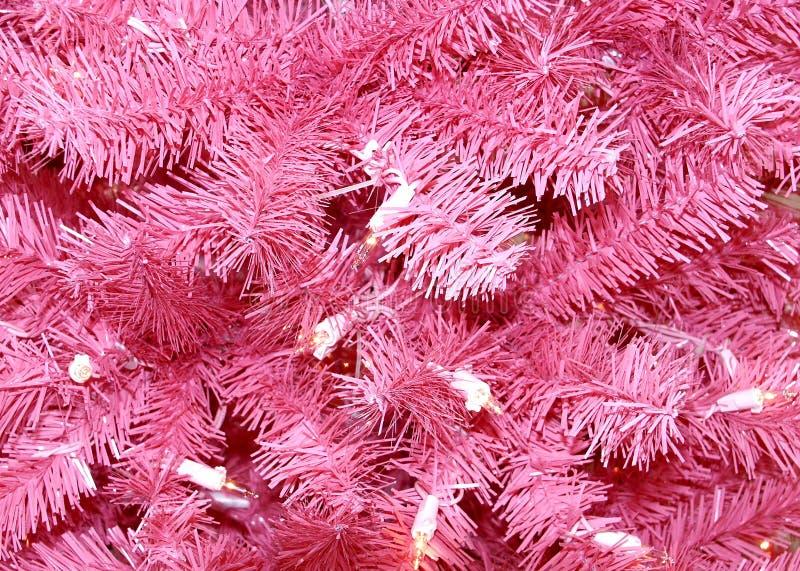 Rosafarbener Weihnachtsbaumhintergrund stockbild