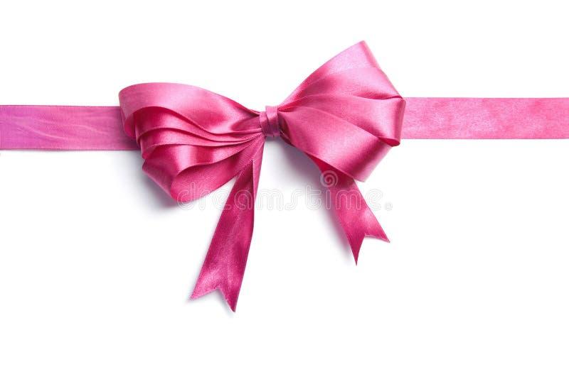 Rosafarbenes Farbband mit dem Bogen getrennt stockbilder