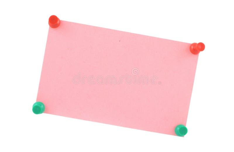 Rosafarbenes Papierblatt festgesteckt stockbild