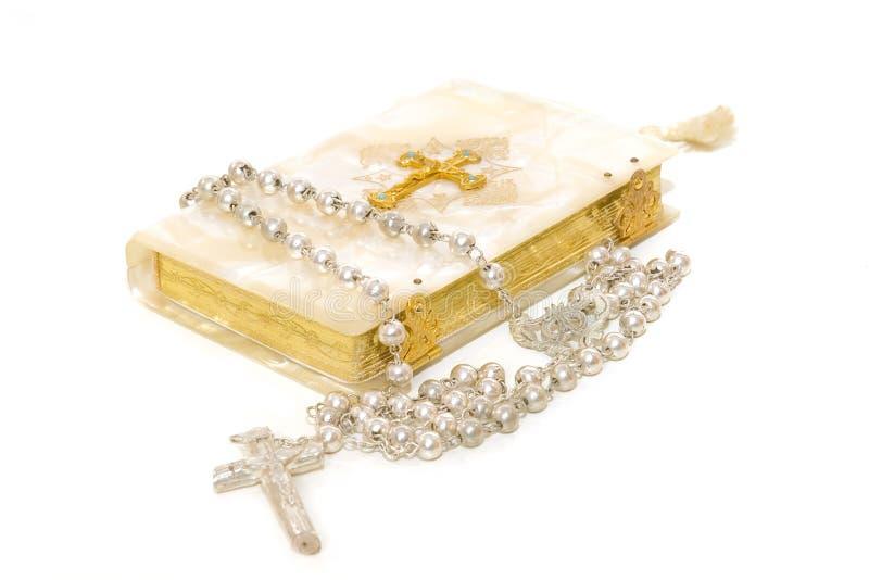 Rosaire et premier livre de communion photographie stock