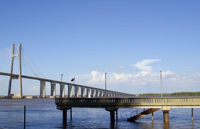 Rosario-Victoria Bridge and Paraná river, in Rosario, Argentina. Seen from the coastline royalty free stock image