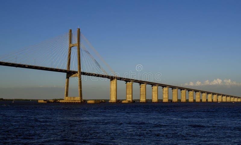 Rosario-Victoria Bridge and Paraná river, in Rosario, Argentina. Seen from the coastline stock image