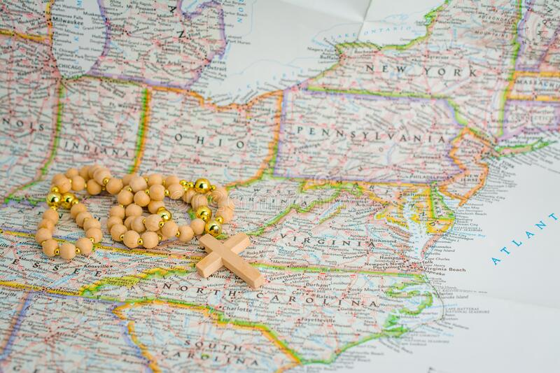 Rosary beads on map. Pray for New York. America, new, york, united, states, belief, bible, study, verses, catholic, christ, christian, christianity, church stock image