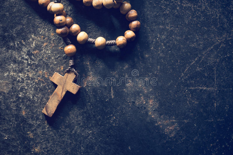 Rosary beads. On old black background royalty free stock photography