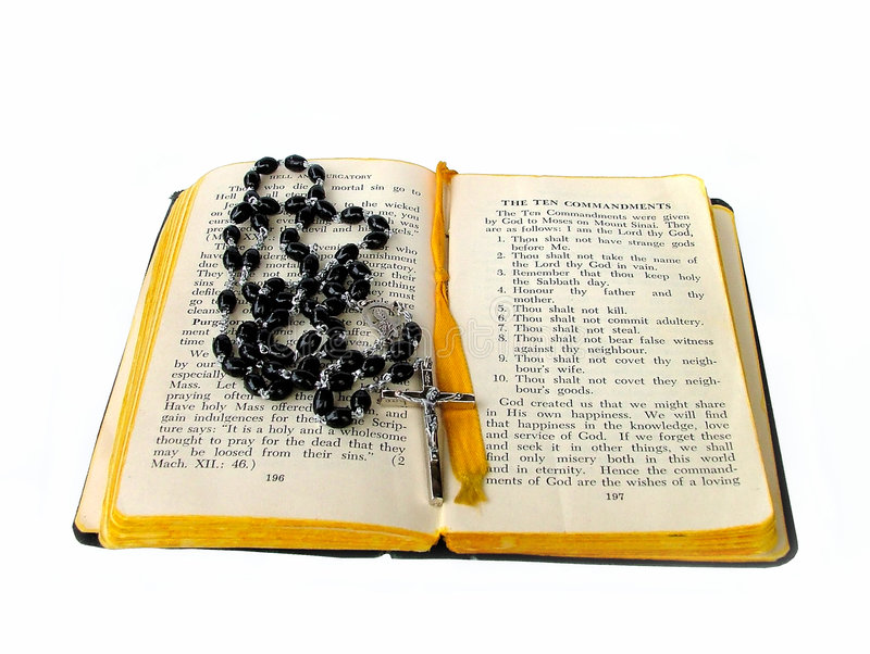 Rosary beads open bible stock image