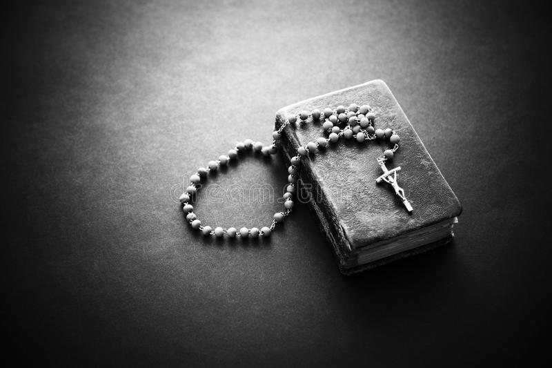 Rosary on the Bible royalty free stock photo