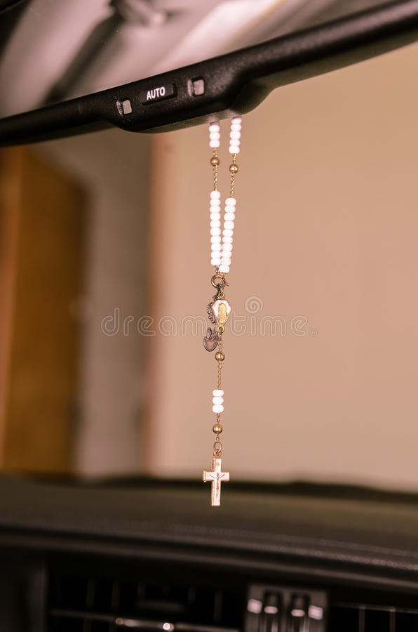 Rosary on car mirror royalty free stock photography
