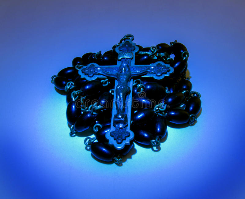Rosary Crucifix in Blue Light royalty free stock images