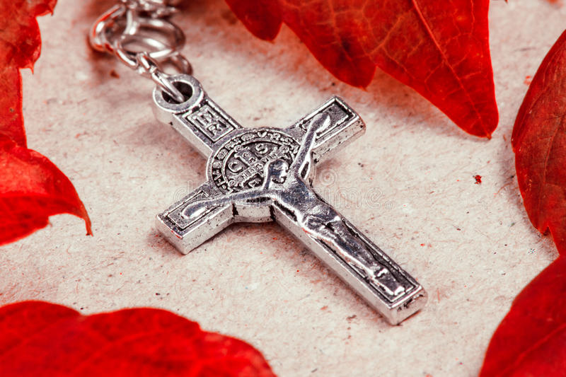 Rosary Crucifix. A rosary crucifix over a paper background royalty free stock photo