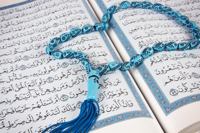 Download Rosary over holy Quran stock photo. Image of ramadan - 28491750