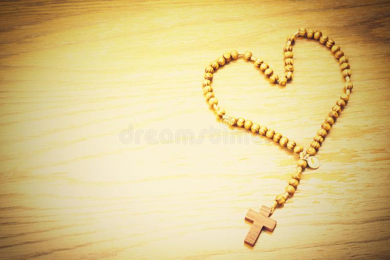 Rosary on a wooden background 1 royalty free stock photography