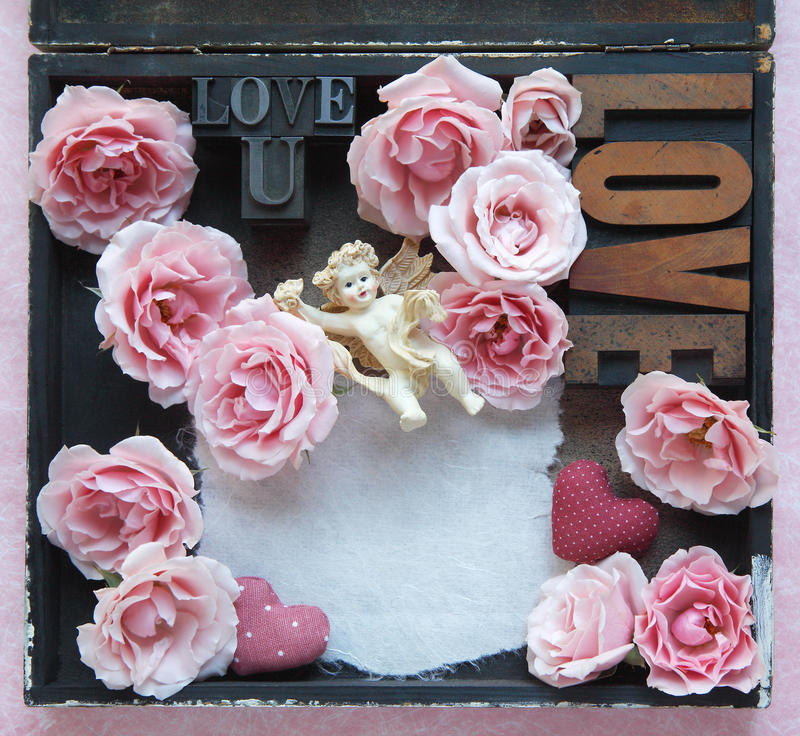 Rosas com palavras do amor e anjo foto de stock royalty free