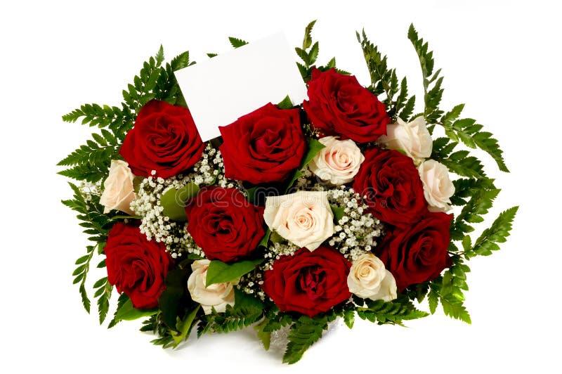 Rosas com vale-oferta fotos de stock