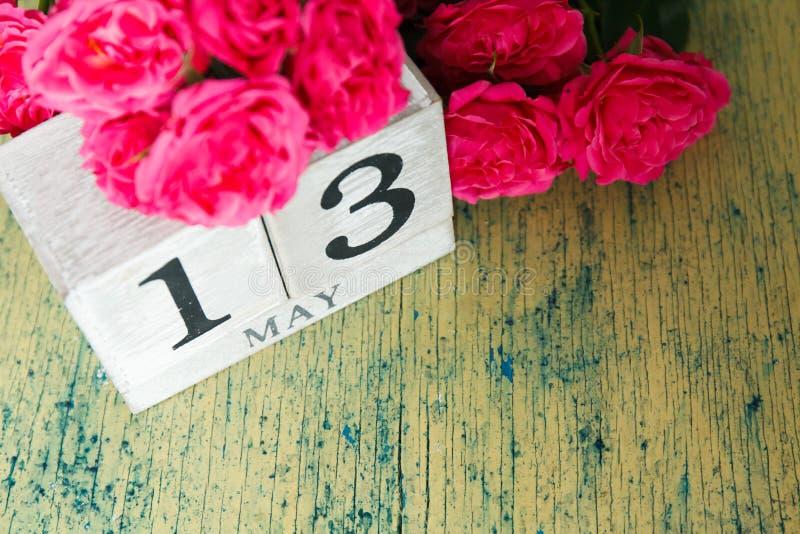 Rosas e calendário imagem de stock