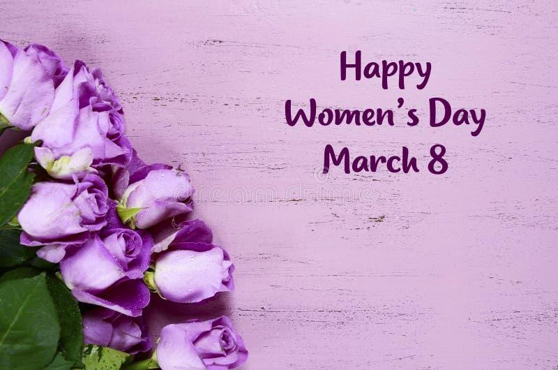 Rosas para mujer internacionales de la púrpura del día fotografía de archivo