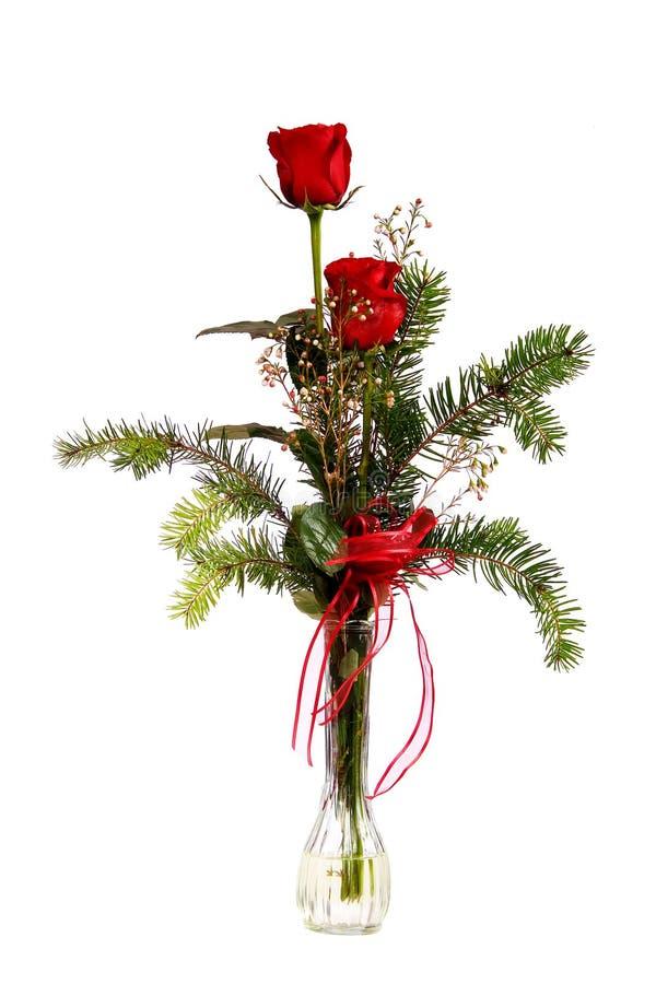 Rosas vermelhas em um vaso de cristal fotografia de stock royalty free