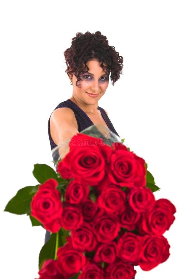 Rosas y alineada rojas de la tarjeta del día de San Valentín fotografía de archivo