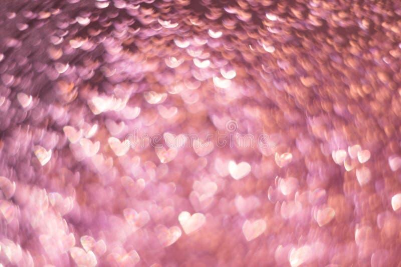 Or rose, bokeh rose rose, fond clair abstrait de coeur, jour de valentines, femmes jour, contexte romantique de lumières d'événem image stock