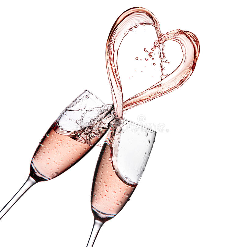 Rose champagne with heart shape splash isolated on a white background royalty free stock photos