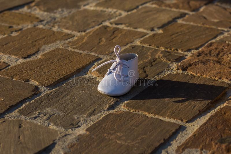 Baby shoe on sidewalk in Paris, France, Europe. stock images