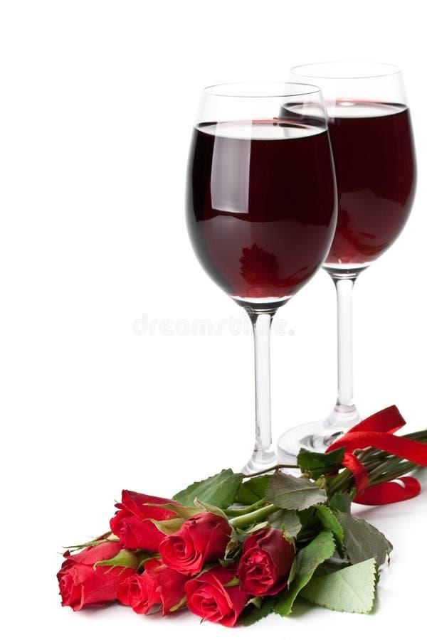 Rose e vino rosso immagini stock