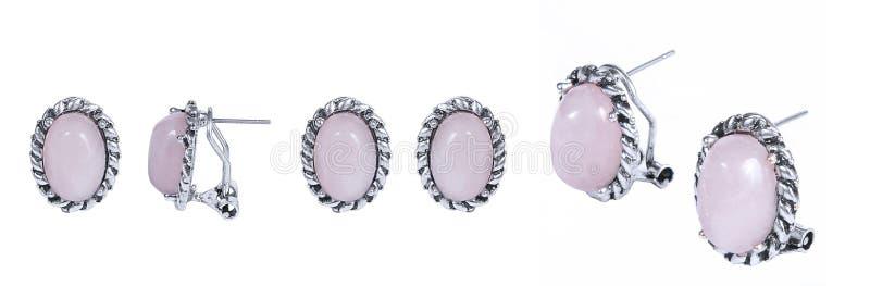 Rose Earrings en un blanco imagen de archivo libre de regalías