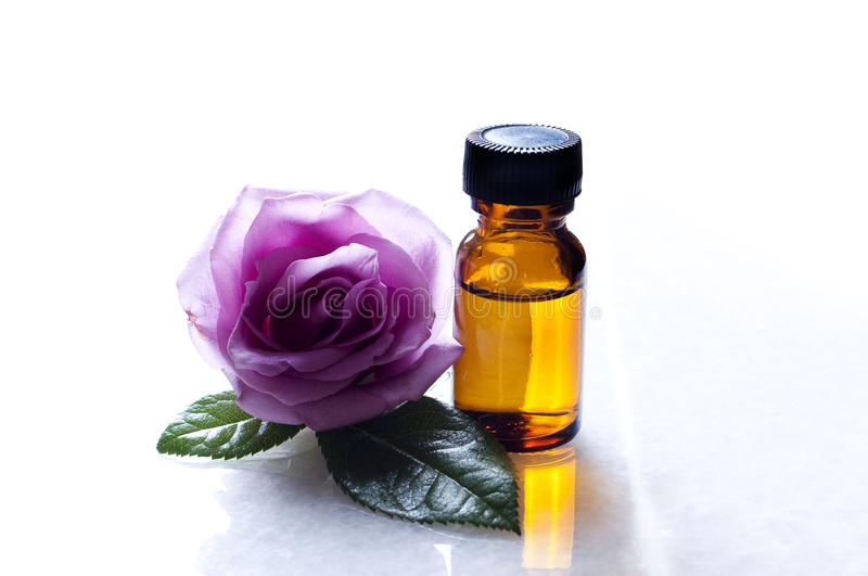 Rose essence oil. Rose of natural essential oils royalty free stock photo