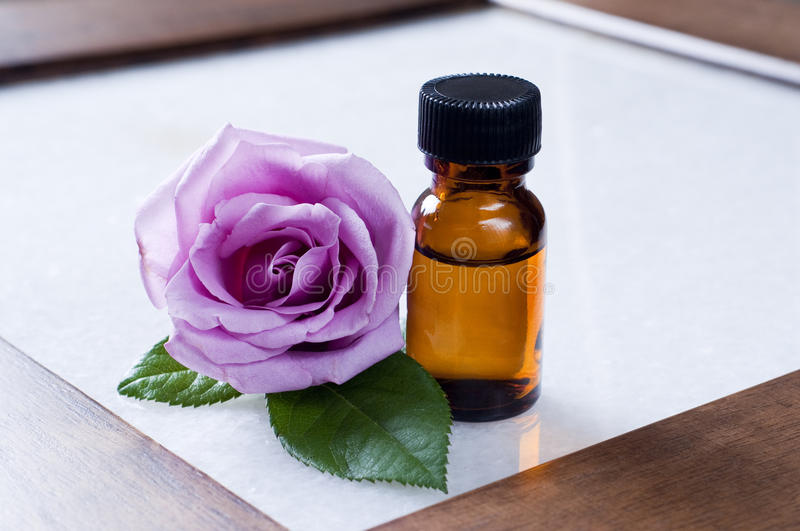 Rose essential oils. Table rose natural essential oils royalty free stock photos