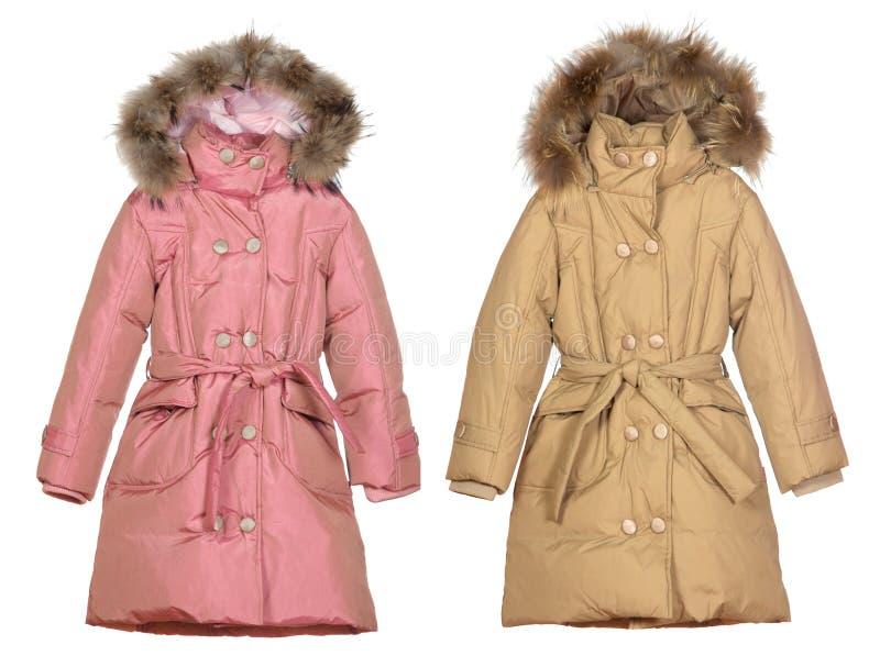 Rose et manteaux femelles beiges d'hiver photographie stock