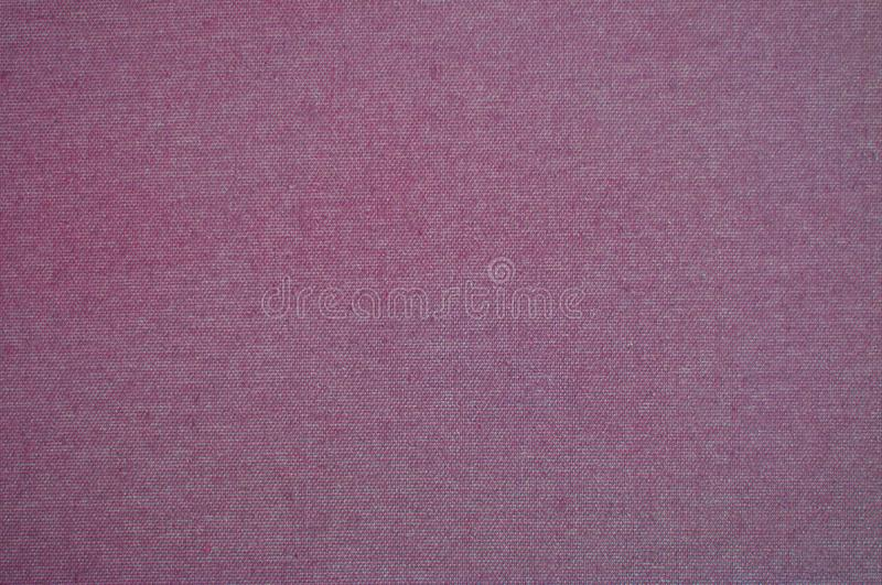 Rose fabric texture, Pink textile backgroung. Factory fabric with pink rose texture stock images