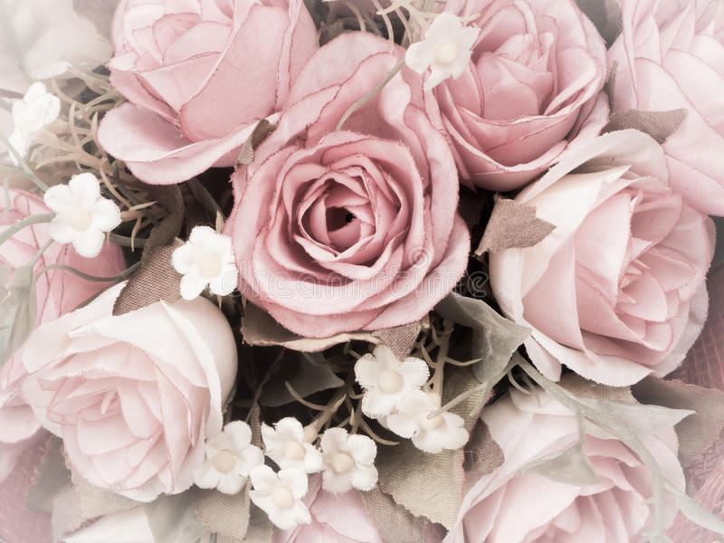 Rose flower with retro filter effect. Close up bouquet of fabric rose flower with retro filter effect royalty free stock photos