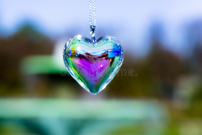 Fountain backgroundheart crystal glass refract sunlight - fountain background. AT 1/4/2019 in Rose garden stock images