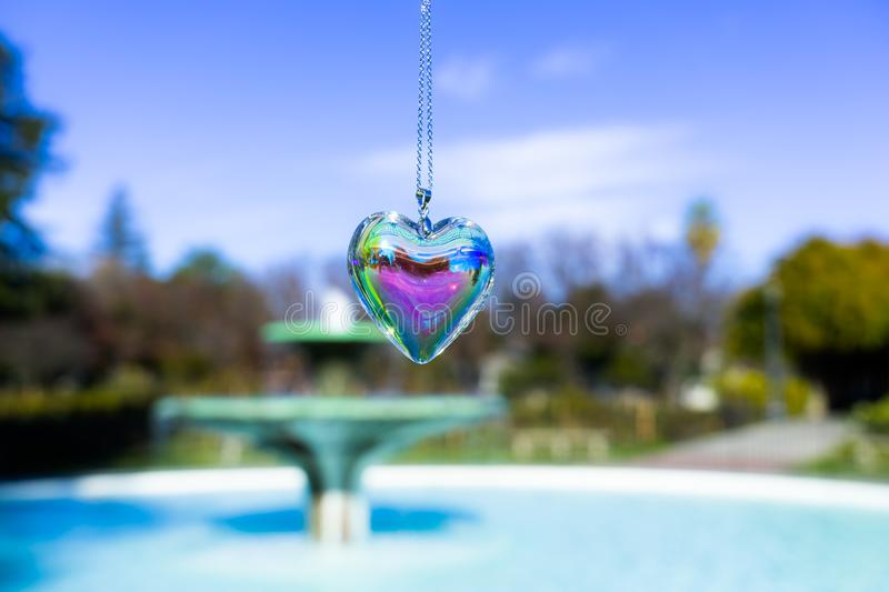 Fountain backgroundheart crystal glass refract sunlight - fountain background. AT 1/4/2019 in Rose garden stock photos
