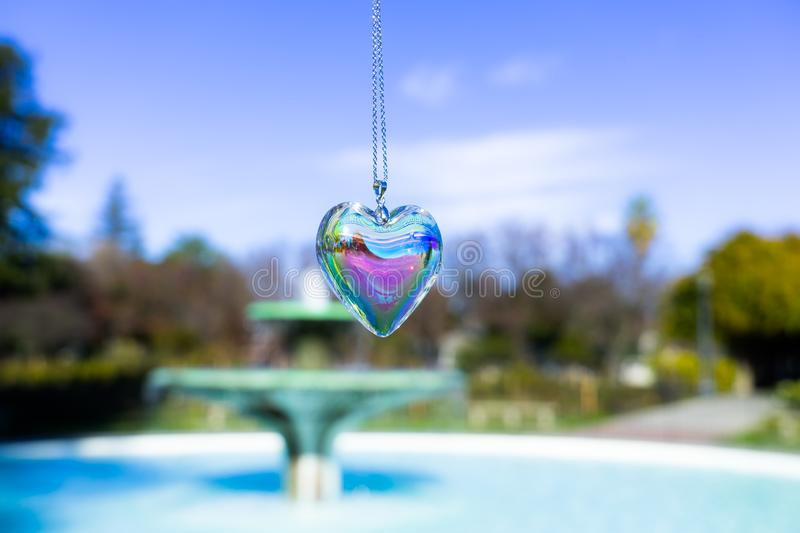 Fountain backgroundheart crystal glass refract sunlight - fountain background. AT 1/4/2019 in Rose garden stock photo