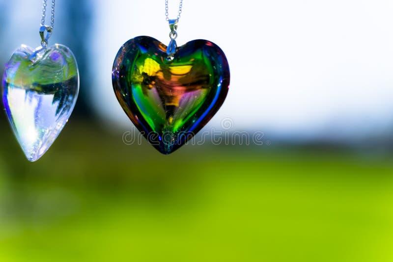 Heart crystal glass refract sunlight - sunlight clock backgroundheart crystal glass refract sunlight - rose garden background. AT 1/4/2019 in Rose garden royalty free stock image