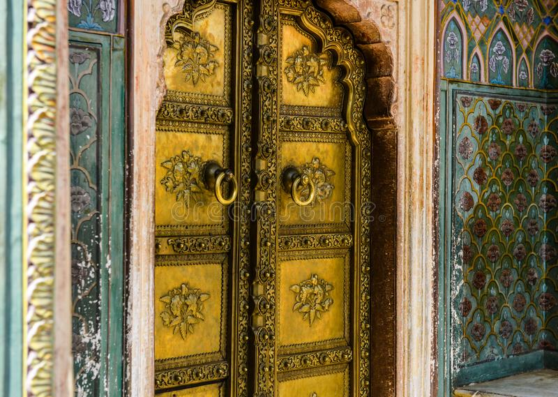 Rose Gate in City Palace, Jaipur, India. Rose Gate Winter Gate is located in the City Palace, Jaipur, India, filled with repeating rose patterns, it is dedicated stock image