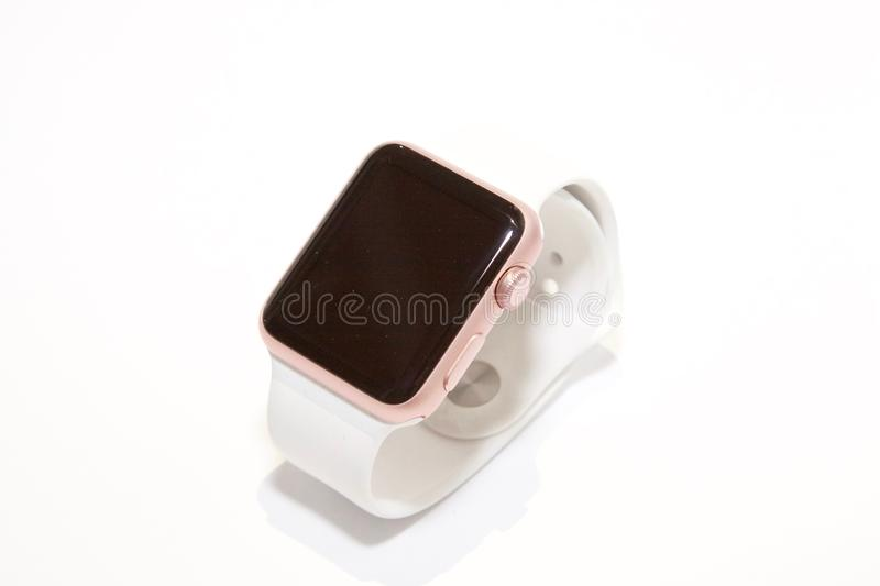 Rose Gold Aluminum Case Apple Watch With White Sports Band royalty free stock image