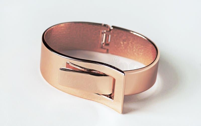 Rose Gold Expandable Bracelet. Rose gold, fashion, expandable bracelet isolated on white royalty free stock image