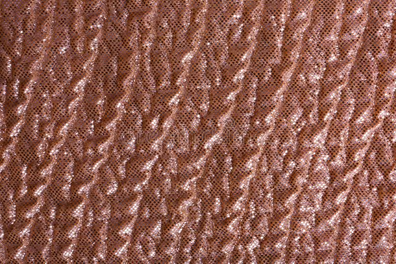 Rose gold fabric with shiny paillettes as background. Top view royalty free stock photo