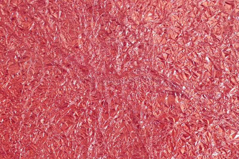 Rose gold foil shiny texture, abstract red wrapping paper for background and design art work stock photo
