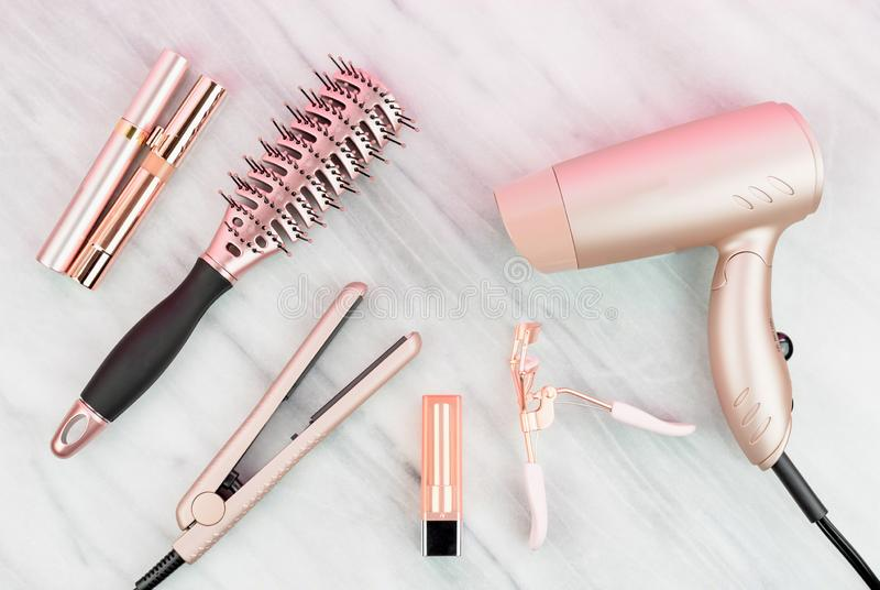 Rose gold hair care and beauty products stock photos