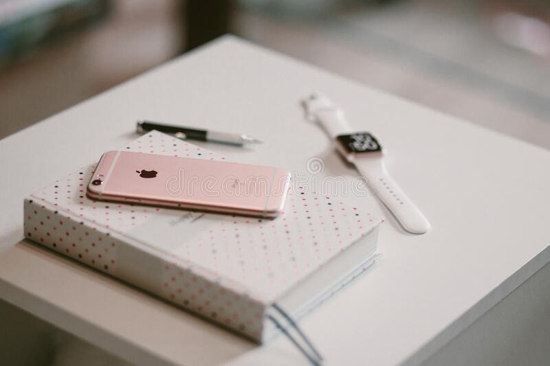 Rose Gold Iphone 6 S On Top Of White Covered Book Free Public Domain Cc0 Image