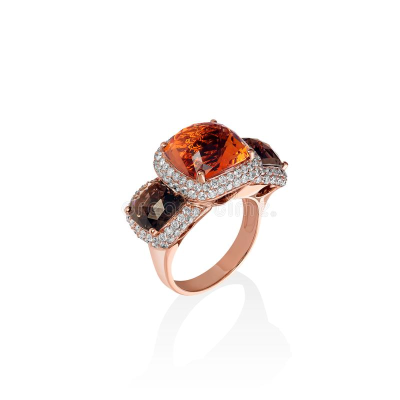 Rose gold ring with brown saphires and multiple diamonds, cushion cut gems royalty free stock photo