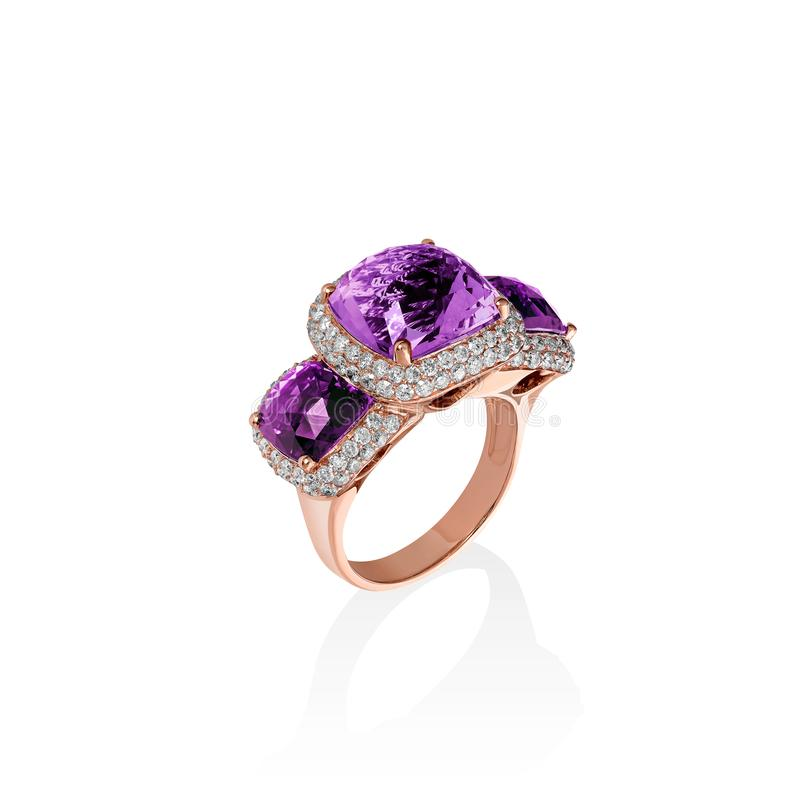 Rose gold ring with purple saphires and multiple diamonds, cushion cut gems royalty free stock images