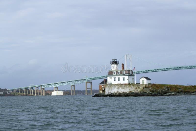 Rose Island Lighthouse and Newport Bridge. In Narangansett Bay, Rhode Island, USA royalty free stock photo