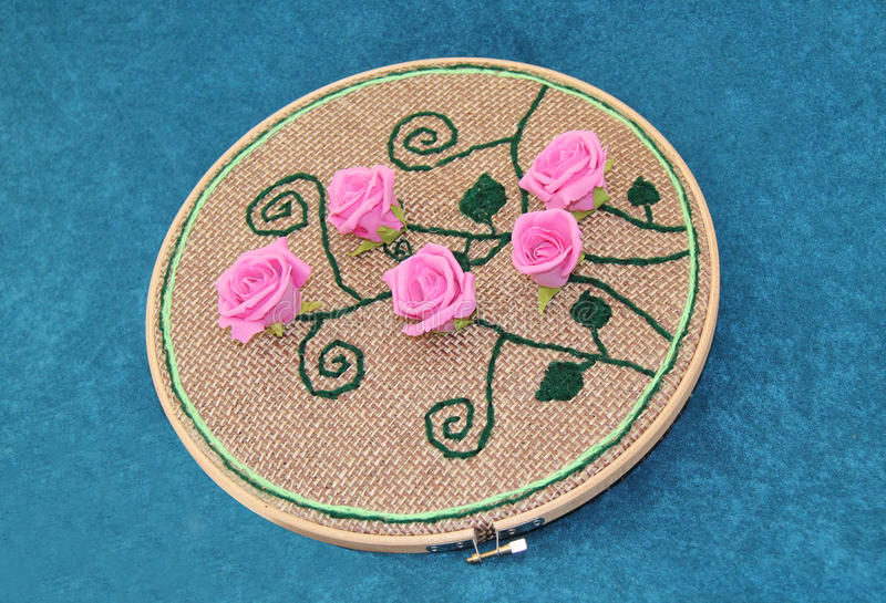 Rose Pattern Embroidery. A Pink Rose Pattern Embroided on to a Round Frame stock photography