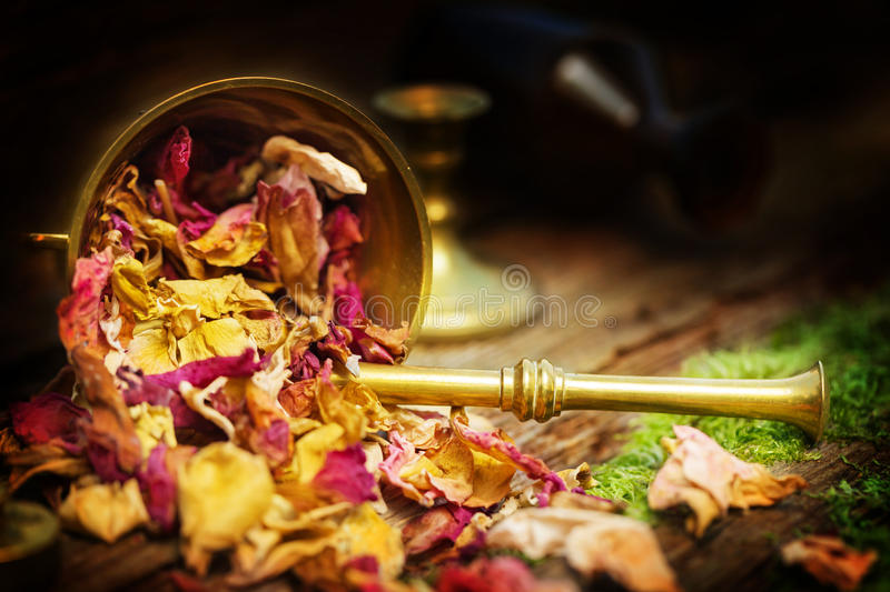 Rose petals in mortar, natural cosmetics royalty free stock image