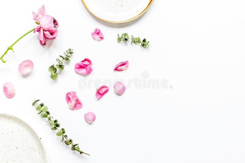 Rose petals and plate flat lay on woman desk top view mockup stock image